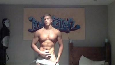 Muscular hunk flexing and wanking