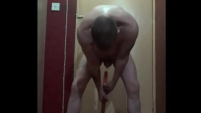 bisexual male inserts a dildo on a stick up his ass and starts riding it till he creams